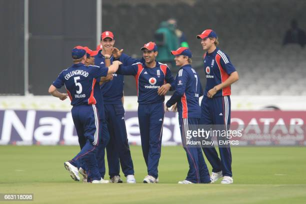 England's Ohah Saha celebrates with his team mates after South Africa's Hashim Amla is run out