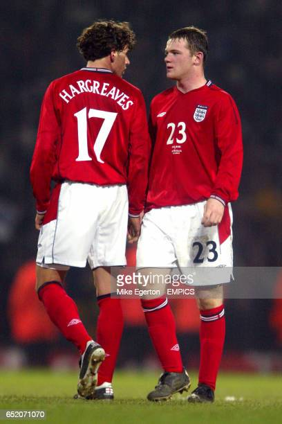 England's Owen Hargreaves and teammate Wayne Rooney have words