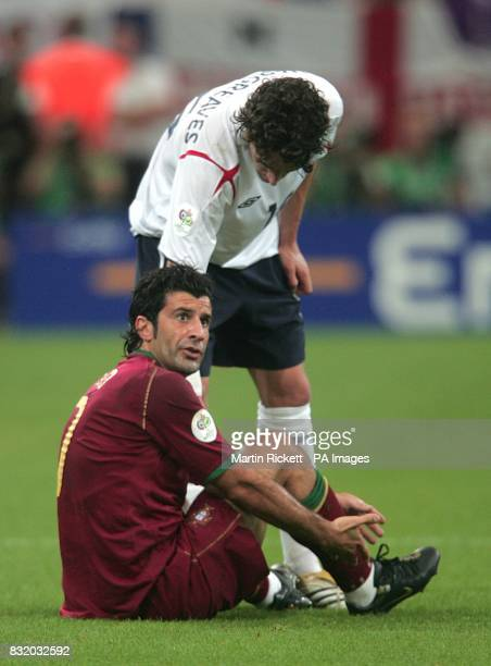 England's Owen Hargreaves helps up Portugal's Luis Figo