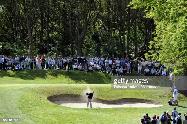 England's Paul Broadhurst plays out of a bunker during Round 3 of the BMW PGA Championship at Wentworth Golf Club Surrey