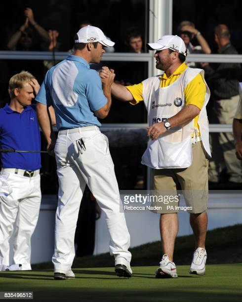 England's Paul Casey celebrates with his caddie on the 18th green after sinking the winning putt during Round 4 of the BMW PGA Championship at...