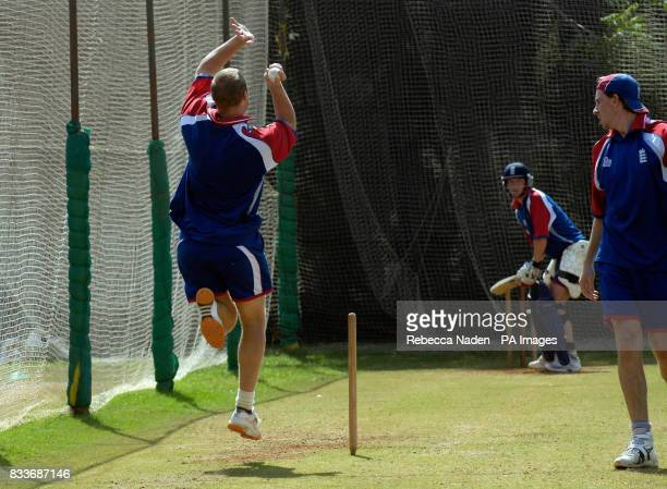 England's Paul Collingwood batting as Rikki Clarke watches captain Andrew Flintoff bowl during a nets practice session at the Sardar Patel Stadium...