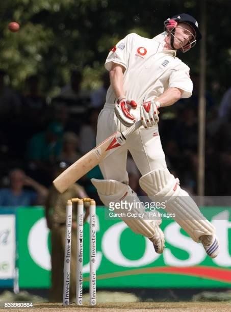 England's Paul Collingwood ducks a bouncer from Sri Lanka's Lasith Malinga during the first Test match at Asgiriya International Stadium Kandy