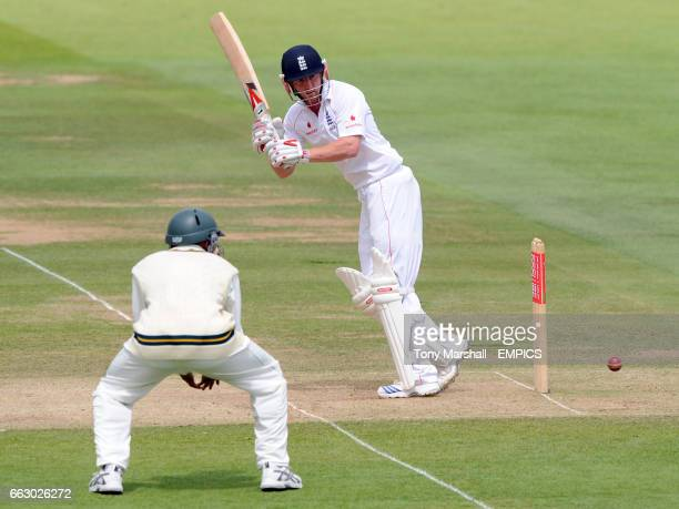 England's Paul Collingwood hits the ball past South Africa's Hashim Amla