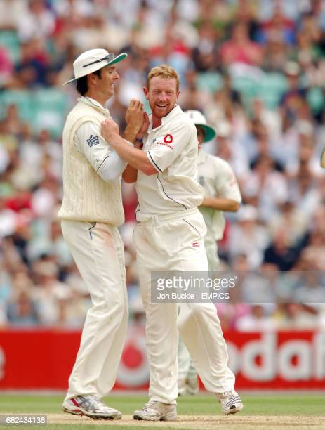 England's Paul Collingwood is congratulated by Michael Vaughan after claiming the wicket of India's Sourav Ganguly