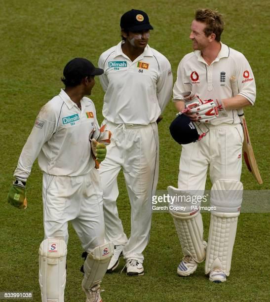 England's Paul Collingwood talks to Sri Lanka's Kumar Sangakkara and Prasanna Jayawardene as they leave the field for the tea interval during the...
