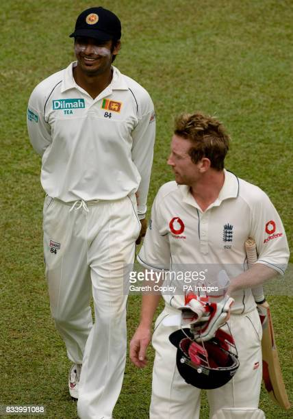 England's Paul Collingwood talks to Sri Lanka's Kumar Sangakkara as they leave the field for the tea interval during the second Test match at...