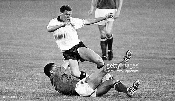 England's Paul Gascoigne is tackled by Republic of Ireland defender Paul McGrath during the FIFA World Cup match between England and the Republic of...