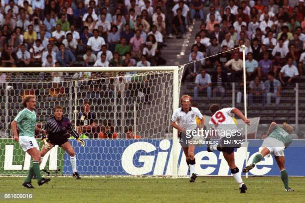 England's Paul Gascoigne lashes a shot past West Germany's Andreas Brehme as teammate Mark Wright and Germany's Rudi Voller and Bodo Illgner look on