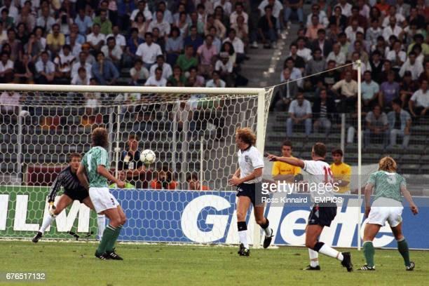 England's Paul Gascoigne shoots towards West Germany goalkeeper Bodo ILLGNER's goal during the match