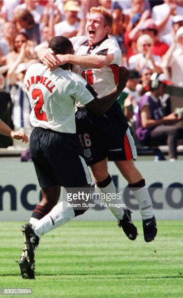 England's Paul Scholes celebrates his goal against Tunisia with team mate Sol Campbell during their first round World Cup match in Marseille today...