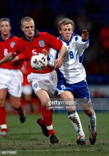 England's Peter Clarke battles for possession of the ball with Finland's Daniel Sjolund