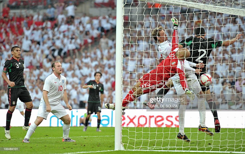 England's Peter Crouch (3rd R) scores during their international friendly football match at Wembley Stadium in London on May 24, 2010 AFP PHOTO/Carl de Souza