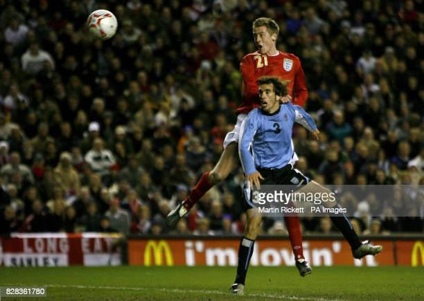 England's Peter Crouch scores his goal past Uruguay's Diego Godin during the friendly International match at Anfield Liverpool Wednesday March 1 2006...
