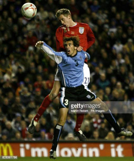 England's Peter Crouch scores his goal past Uruguay's Diego Godin during the friendly International match at Anfield Liverpool