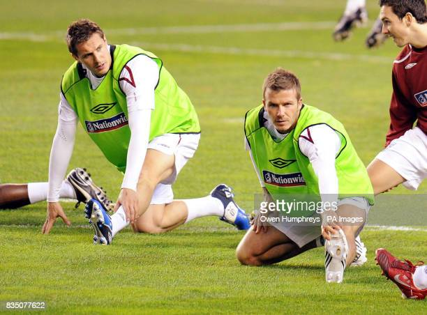 England's Phil Jagielka and David Beckham during a training session at the Ramon Sanchez Pizjuan Stadium in Seville Spain