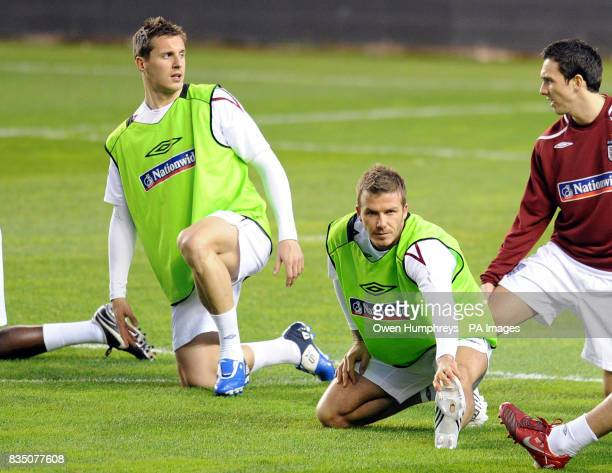 England's Phil Jagielka David Beckham and Stewart Downing during a training session at the Ramon Sanchez Pizjuan Stadium in Seville Spain