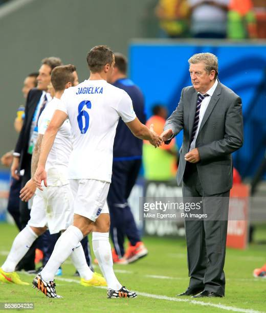 England's Phil Jagielka shakes hands with England manager Roy Hodgson after the FIFA World Cup Group D match at the Arena da Amazonia Manaus Brazil