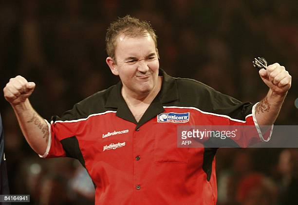 England's Phil Taylor jokes with his fans during his semifinal match against countryman Mervyn King in the 2009 World Darts Championship at London's...