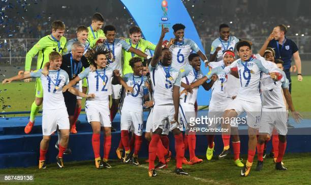 England's players celebrate after winning the final FIFA U17 World Cup football match against Spain at the Vivekananda Yuba Bharati Krirangan stadium...
