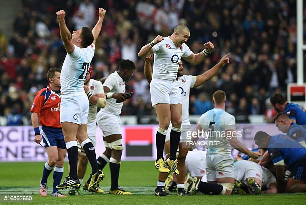 England's players celebrate after winning the Six Nations international rugby union match between France and England at the Stade de France in...