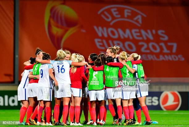 England's players celebrate after winning the UEFA Women's Euro 2017 tournament quarterfinal football match between England and France at Stadium De...