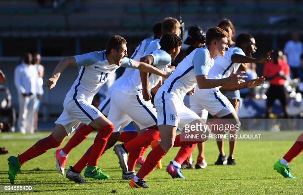 England's players celebrate after winning the Under 21 international football final match England vs Ivory Coast at the De Lattre Stadium in Aubagne...