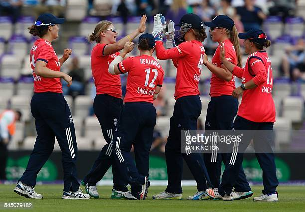 England's players celebrate during the women's International T20 cricket match between England and Pakistan at The Ageas Bowl in Southampton on July...