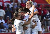 England's players celebrate scoring their second goal against Norway during a 2015 FIFA Women's World Cup Round of 16 football match at Lansdowne...