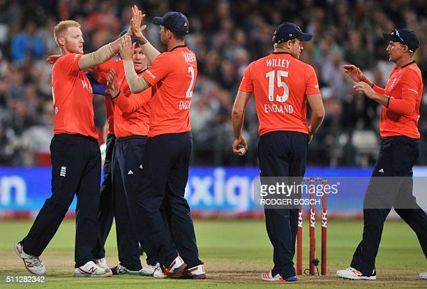 England's players celebrate the dismissal of South Africa's Hashim Amla during the first of two T20 matches being played against South Africa at...