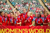 England's players celebrate their 10 win over Germany in the bronze medal match at the FIFA Women's World Cup in Edmonton Alberta on July 4 2015 AFP...