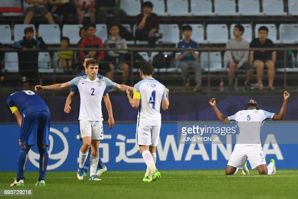 England's players celebrate their victory during the U20 World Cup semifinal football match between England and Italy in Jeonju on June 8 2017 / AFP...