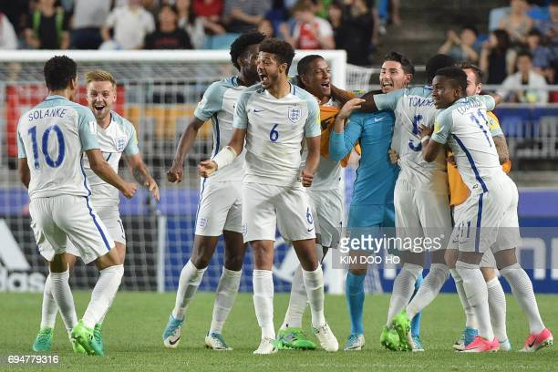 England's players celebrate their victory during the U20 World Cup final football match between England and Venezuela in Suwon on June 11 2017 / AFP...