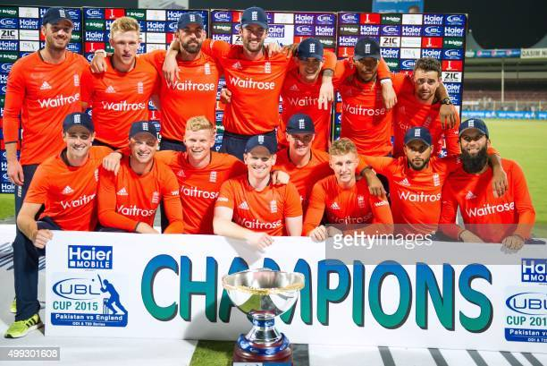 England's players celebrate their victory of the series at the end of the third T20 cricket match between Pakistan and England at the Sharjah Cricket...