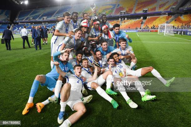 England's players celebrate winning the U20 World Cup final football match between England and Venezuela in Suwon on June 11 2017 / AFP PHOTO / JUNG...