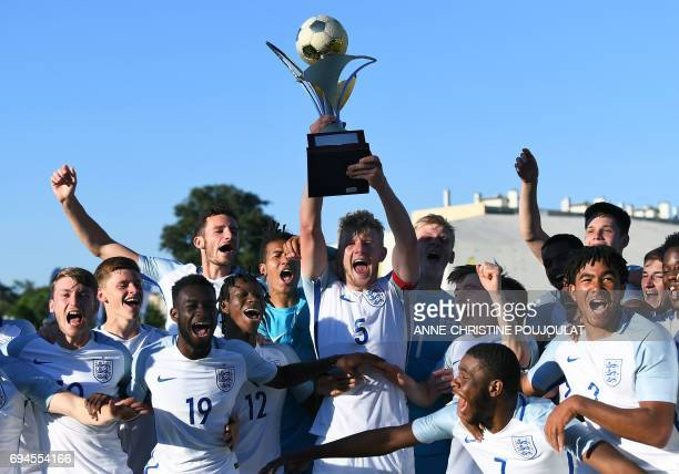 England's players celebrate with the trophy after winning the Under 21 international football final match England vs Ivory Coast at the De Lattre...