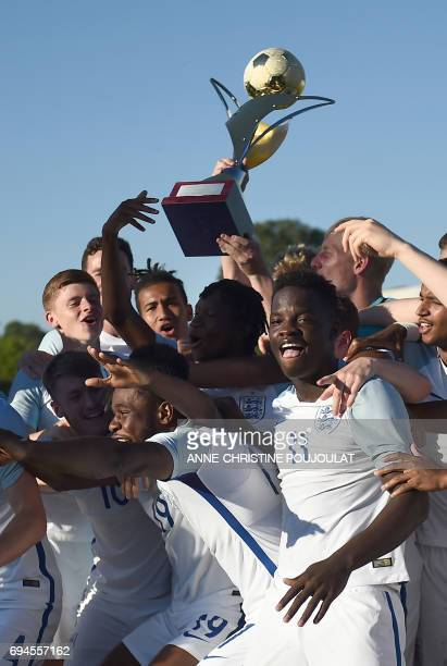 England's players celebrate with trophy after winning the Under 21 international football final match England vs Ivory Coast at the De Lattre Stadium...