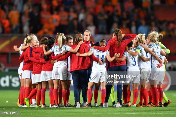 England's players huddle after losing the UEFA Womens Euro 2017 football tournament semifinal match between Netherlands and England at the FC Twente...