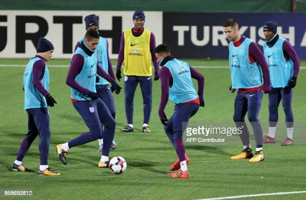 England's players including defender Chris Smalling and midfielder Jesse Lingard take part in a training on October 7 2017 in Vilnius Lithuania on...