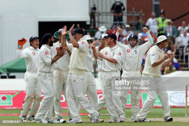England's players jump to celebrate with Monty Panesar after the 3rd umpire give Pakistan captain Inzaman UlHaq out during the third day of the...