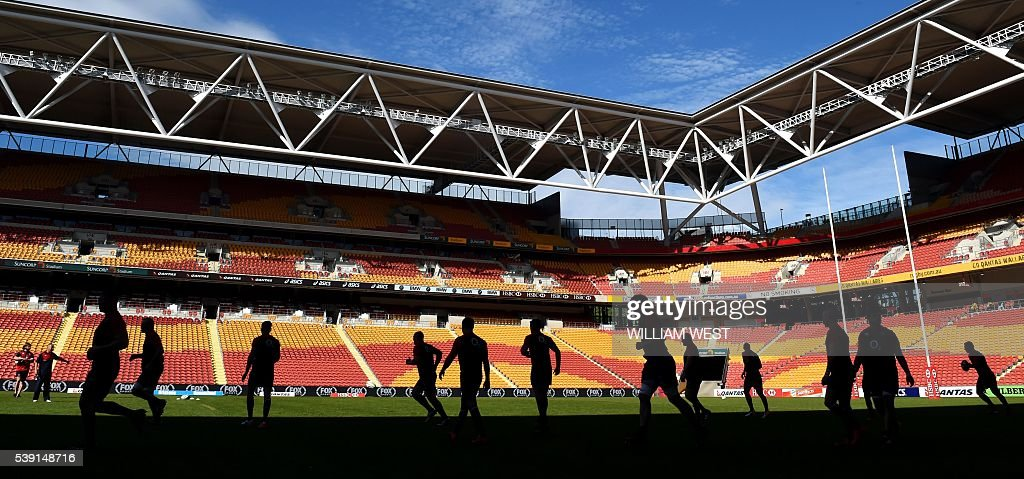 TOPSHOT England's players run onto the ground during the captain's run in Brisbane on June 10 ahead of the first rugby Test match against Australia...
