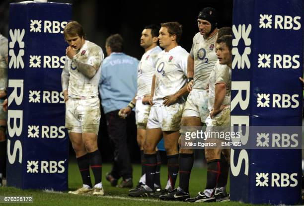 England's players stand dejected under the posts after Tommy Bowe scores the winning try