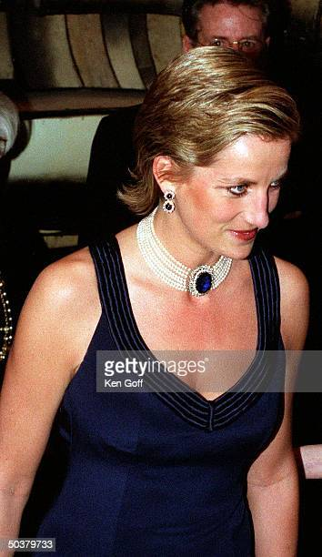 England's Princess Diana in a new sleek hairstyle jeweled choker earrings navy blue strapped gown at a charity gala dinner at the Lincoln Center for...