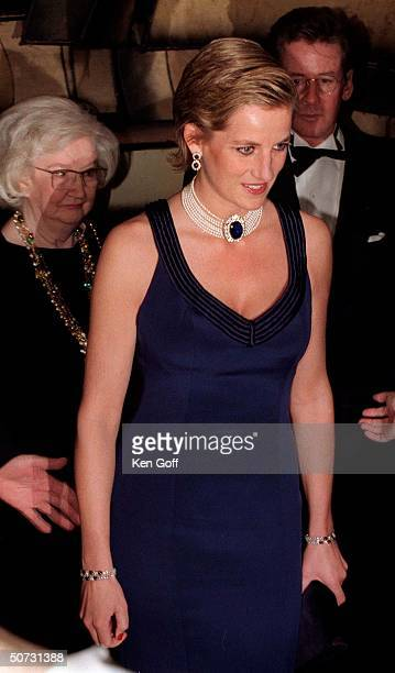 England's Princess Diana in a new sleek hairstyle jeweled choker navy blue strapped gown at a charity gala dinner at the Lincoln Center for the...