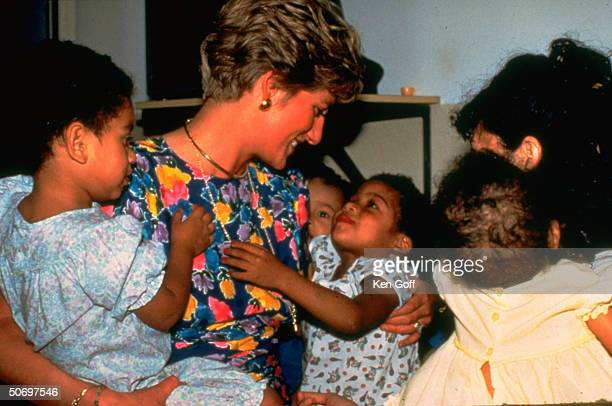 England's Princess Diana with 3yrold AIDS sufferer Thais Bispo dos Santos others at a Sao Paolo shelter for abandoned children with AIDS