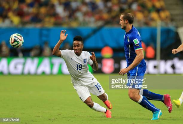 England's Raheem Sterling and Italy's Giorgio Chiellini battle for the ball during the FIFA World Cup Group D match at the Arena da Amazonia Manaus...