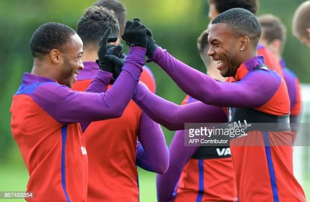 England's Raheem Sterling and teammate Daniel Sturridge train during a national football team training session at the Tottenham Hotspur Training...