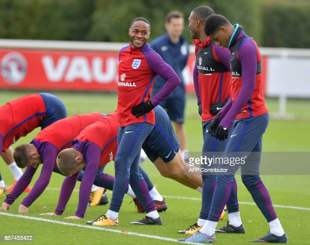 England's Raheem Sterling Daniel Sturridge and Marcus Rashford train during a national football team training session at the Tottenham Hotspur...