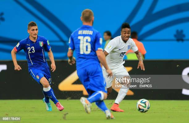 England's Raheem Sterling gets away from Italy's Marco Verratti during the FIFA World Cup Group D match at the Arena da Amazonia Manaus Brazil