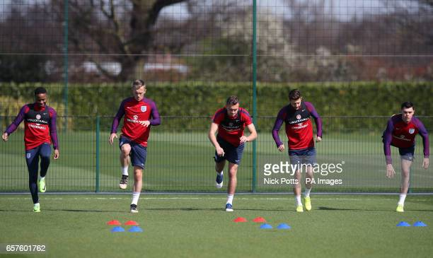 England's Raheem Sterling James WardProwse Ben Gibson Adam Lallana and Michael Keane during the training session at Enfield Training Ground London